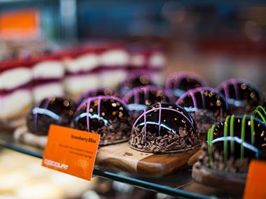 Own a unique cafe business serving wickedly delicious chocolates desserts coffee